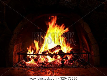 The Photo Of Fireplace. Warm Hearth In Dark.