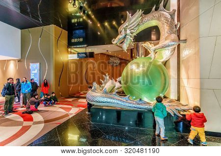 Macao, China - January 24, 2016: Big Illuminated Sculpture Of Colorful Chinese Dragon Holding Pearl