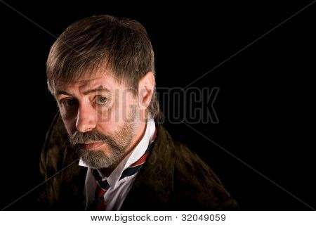 Portrait of a fashionable middle-aged man looking up