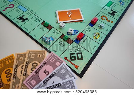 Orlando,fl/usa-8/29/19: The Board And Pieces For The Game Monopoly By Hasbro On A White Background.