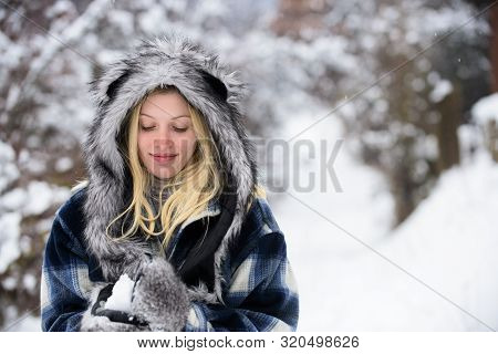 Girl Playing With Snow. Season Of Winter. Wintertime. Smiling Woman In Warm Clothing With Snowball.
