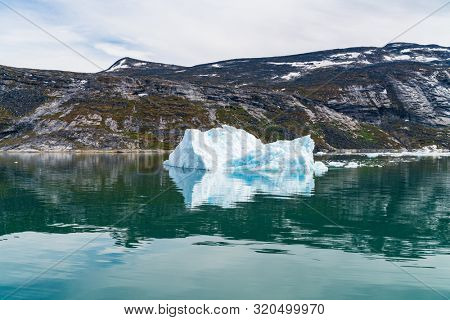 Photo of Iceberg and ice from glacier in arctic nature landscape on Greenland. Icebergs in Ilulissat icefjord. Affected by climate change and global warming.
