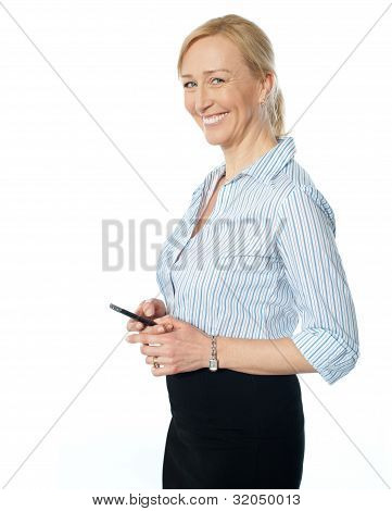 Beautiful Corporate Female Using Cellphone