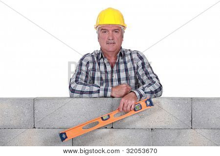 Stonemason holding a bubble level