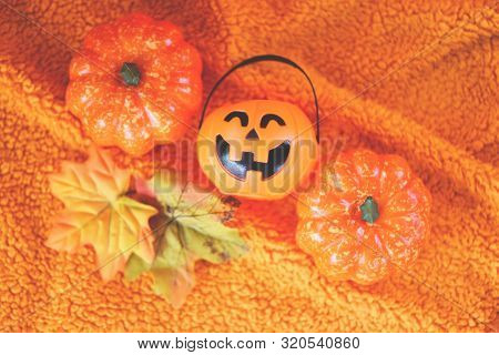 Halloween Decoration Accessories Holiday With  Pumpkin Jack O Lantern And Leaves Autumn On Orange To