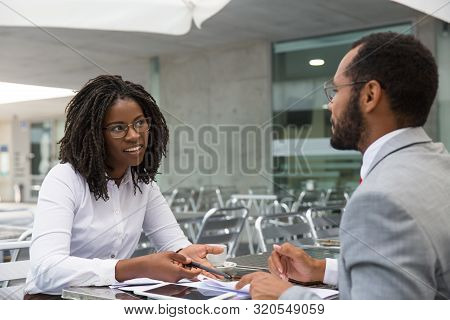 Businesswoman Consulting Legal Experts In Coffee Shop. Business Man And Woman Meeting In Street Cafe