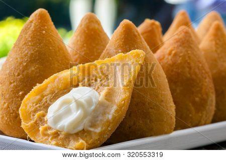 Coxinha of chicken, Brazilian snack and catupiry