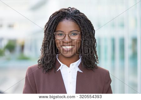 Happy Successful Business Professional Posing Outside. Attractive Young Black Business Woman Wearing