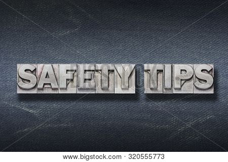 Safety Tips Phrase Made From Metallic Letterpress On Dark Jeans Background