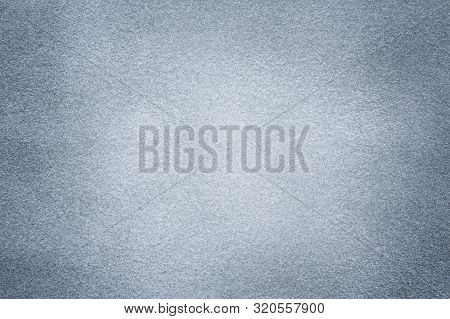 Background Of Light Gray Suede Fabric Closeup. Velvet Matt Texture Of Silver Nubuck Textile With Dar