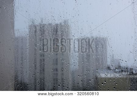 City View Through Wet Rainy Window/ Raindrops On Window Glass, Rainy Day, Looking Trough Window