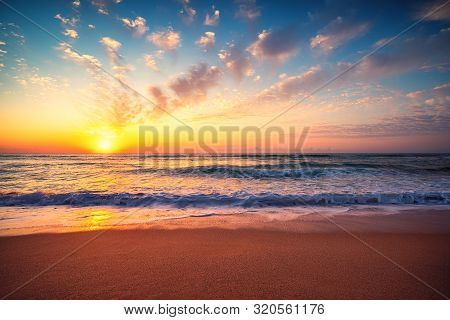 Beautiful Sunset Over The Tropical Sea. Ocean Sunrise And Beach.