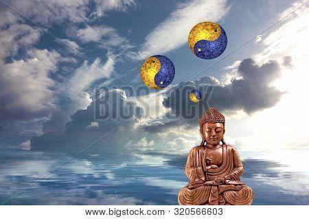 Budha Meditating In Sea Reflection With Yin-yang Symbol