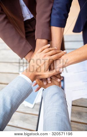 Successful Business Team Expressing Unity And Putting Their Hands Together. Closeup Of People Stacki