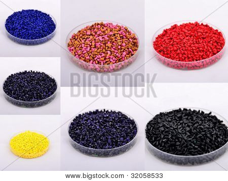 Colored polymer granules were shot in plastic cap. poster
