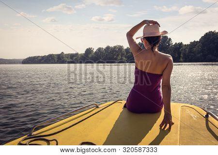 Traveler Girl Relaxing On Boat Floating On River. Young Girl Traveler Relaxing In Vacation. Traveler