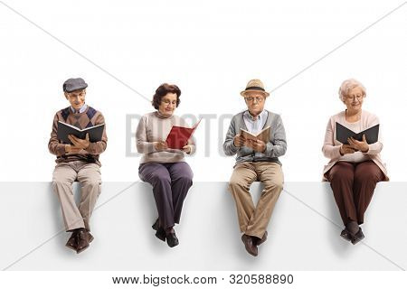 Group of elderly people sitting on a white panel reading books isolated on white background
