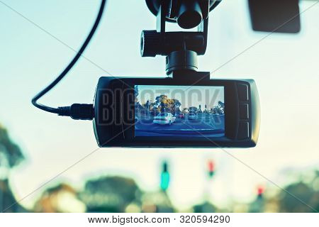 Dashboard Camera In Action Installed On Car Windscreen