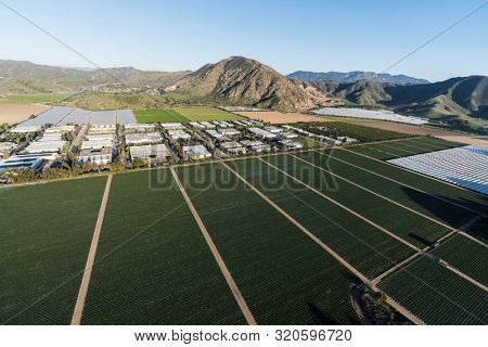 Aerial view of Camarillo farm fields and industrial buildings north of Los Angeles in Ventura County, California.