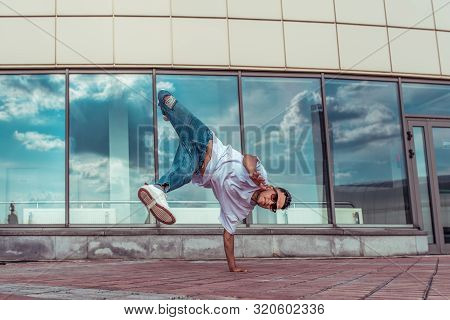 Strong Sporty Man Dancing Break Dance, Stands One Arm Red-haired, Young Guy, Motivation And Lifestyl