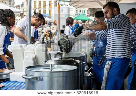 Great Lille Braderie (braderie De Lille).restaurant Staff Prepare Traditional Dish On Lille Braderie