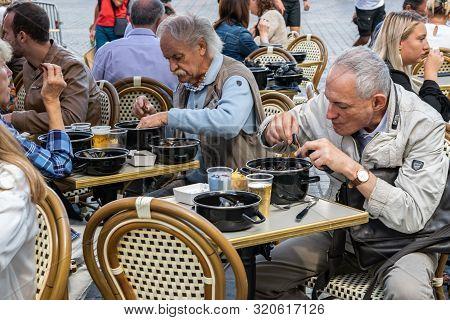 Lille,france-september 01,2019: Great Lille Braderie (braderie De Lille).happy People Eating Traditi
