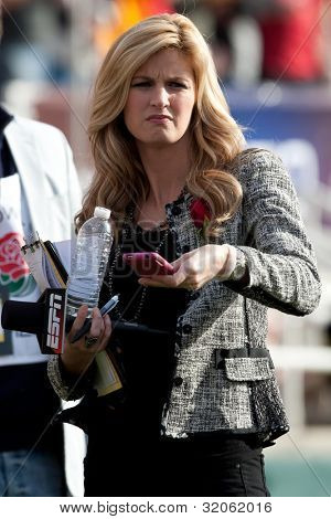 PASADENA, CA. - JAN 1: ESPN reporter Erin Andrews takes pictures with her Iphone during the 2011 Rose Bowl game on Jan 1 2011 at The Rose Bowl in Pasedena, CA.