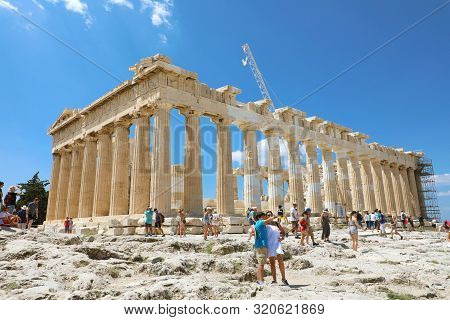 Athens, Greece - July 18, 2018: Tourists Take Picture Near Parthenon Temple On The Acropolis Of Athe