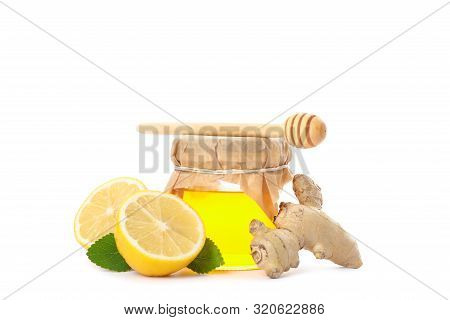 Dipper, Lemons, Ginger And Glass Jar With Honey Isolated On White Background