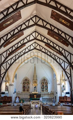 Puerto Princesa, Palawan, Philippines - March 3, 2019: Ceiling, Nave And Chancel With Altar Of Immac