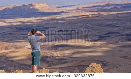 Tourist On The Peak Of Mount Negev Are Viewing A Crater Makhtesh Ramon, Makhtesh Ramon, A Geological