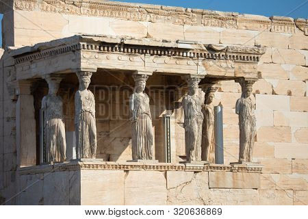 Porch of the Caryatids in Erechtheion, an ancient Greek temple on the north side of the Acropolis of Athens in Greece poster