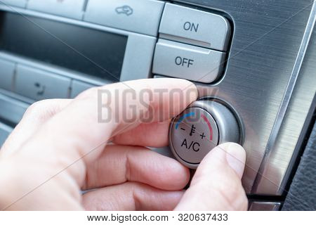 Driver Hand Tuning Temperature Control Knob In Car Air Conditioning System Close Up, Comfort And Fre