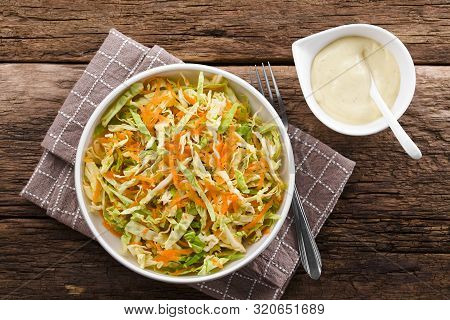 Coleslaw Made Of Freshly Shredded White Cabbage And Grated Carrot With Homemade Mayonnaise-based Sal