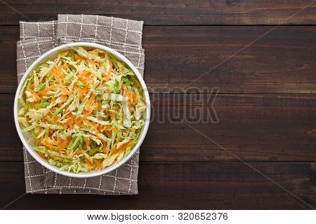 Coleslaw Made Of Freshly Shredded White Cabbage And Grated Carrot Served In Bowl, Photographed Overh