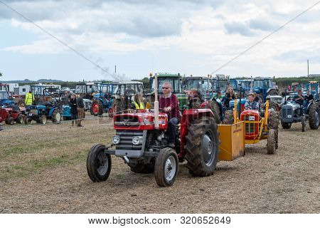 Haselbury Plucknett.somerset.united Kingdom.august 18th 2019.vintage Tractors Are Being Driven At A