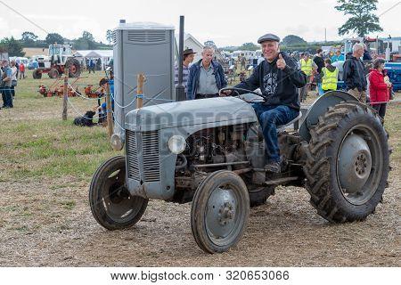 Haselbury Plucknett.somerset.united Kingdom.august 18th 2019.a Massey F erguson T20 Is Being Driven
