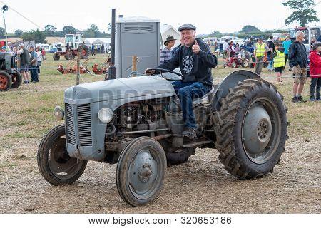 Haselbury Plucknett.somerset.united Kingdom.august 18th 2019.a Massey F|erguson T20 Is Being Driven