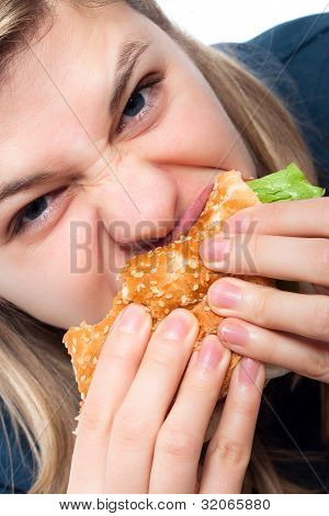 Hungry Woman Eating Hamburger