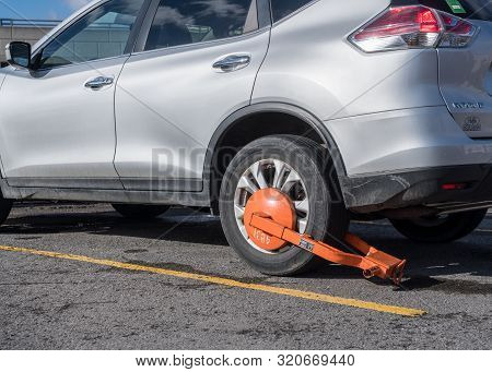 Morgantown, Wv - 23 March 2019: Parked Car With Orange Clamp Or Boot Attached To Wheel For Illegal P