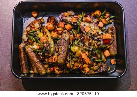 Baking Tray With Vegan Sausages Potatoes And Mixed Roasted Veggies, Healthy Vegetarian Recipes