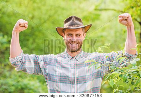 Successful Sexy Farmer. Muscular Ranch Man In Cowboy Hat Care Plants. Farming And Agriculture. Garde