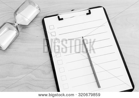 Productivity Themed Still-life With Blank Checklist And Hourglass