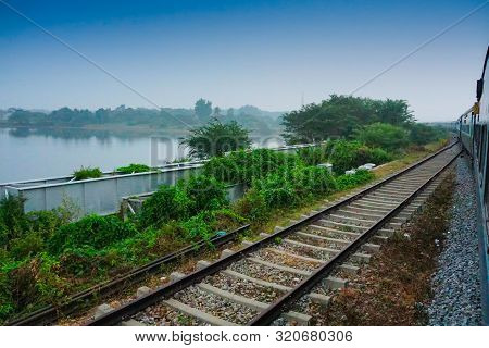 A Train Passing Beside Backwaters Of Kerala, India - The Kerala Backwaters Are A Network Of Brackish