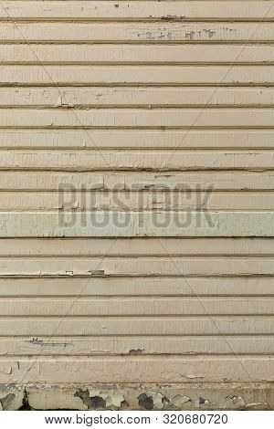 Texture Of Old Peeling Paint On Neglected Wooden Exterior Wall