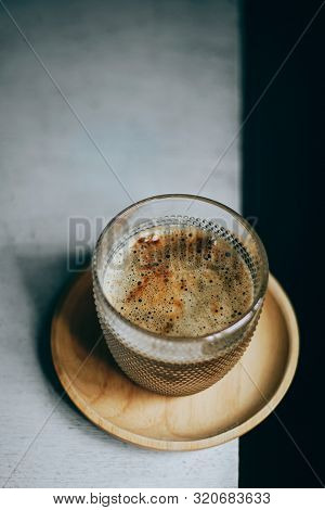 Close Up Cup Of Coffee On White Table