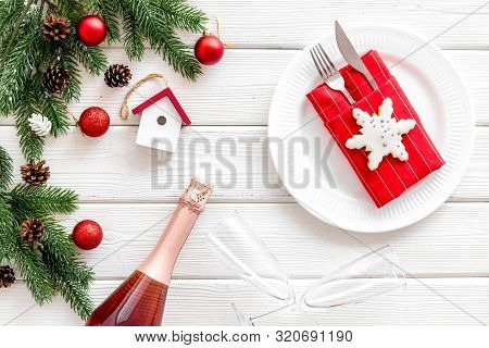Table Setting With Spruce, Plate, Flatware On White Wooden Background Top View