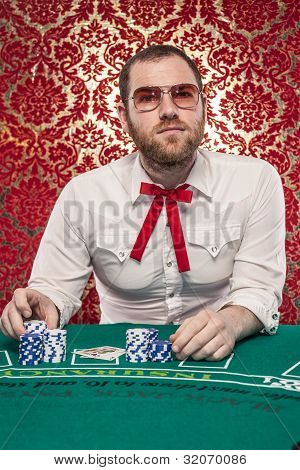 Man Playing Blackjack Wearing Glasses, Texas Tie