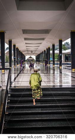 Kuala Lumpur, Malaysia - July 14, 2019: Old Man With Green Traditional Baju Melayu With Sarong Or Ka