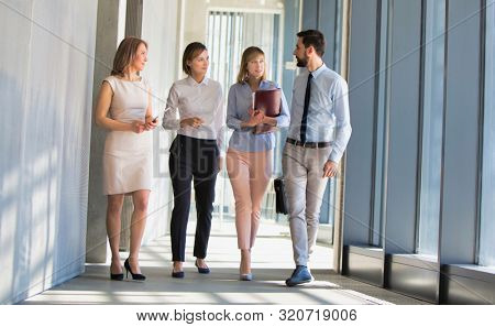 Business people discussing business plans standing in office hall